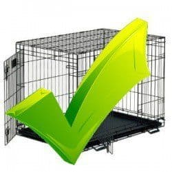 When to use a dog crate - Large green tick on a dog crate