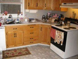 A messy kitchen illustrating the importance of puppy proofing the room