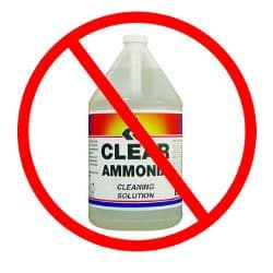 A bottle of ammonia based cleaner in a do not use red circle