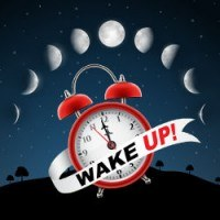 Alarm clock and banner saying wake up beneath the phases of the moon