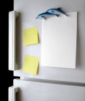 2 post it notes and some paper on a fridge door