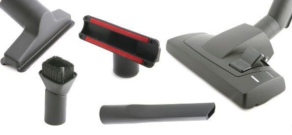 An assortment of vacuum accessories on white bg