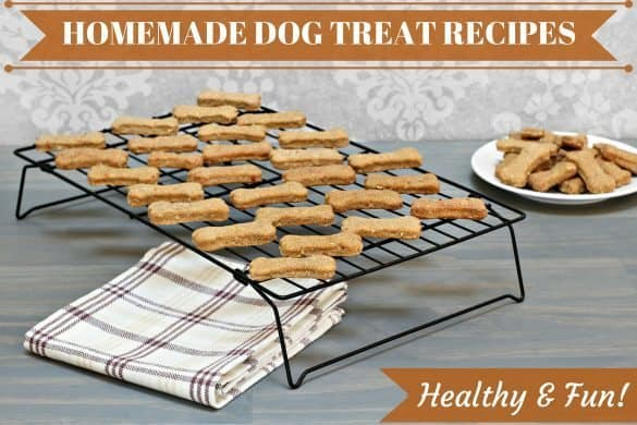 A rack of healthy and easy homemade dog treat recipes above a tea towel on a kitchen counter