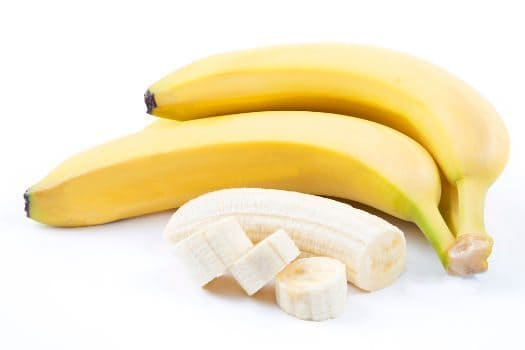 2 whole bananas and one peeled and diced on white bg