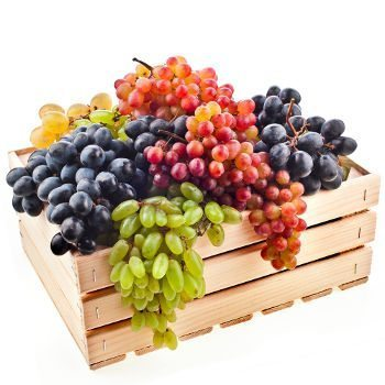 Mixed bunches of grapes in crate on white bg